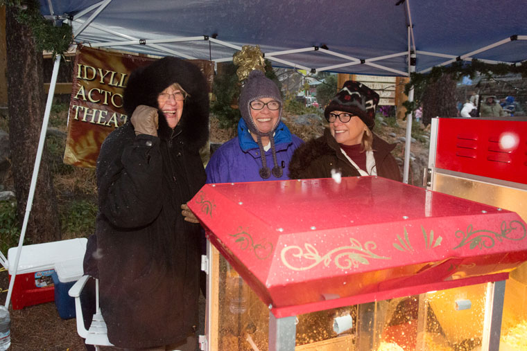 Many local groups helped make the Idyllwild Tree Lighting warmer. Here, the Idyllwild Actors Theatre popcorn stand was womaned by Corrine Brown, Michèle Marsh and Suzanne Avalon.