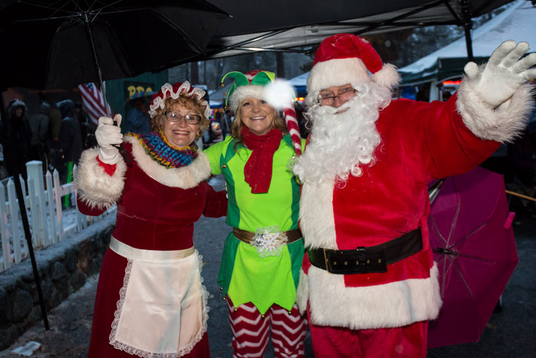 Santa Claus (Joe McNabb) and Mrs. Claus (Emily Pearson) brought an elf (Martha Johnston) to the Christmas Tree Lighting.