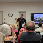Standing-room-only audience comes to hear bear talk