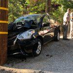 Power pole survives; Nissan succumbs
