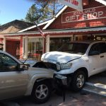 Traffic collision pushes parked truck into Gift Shop