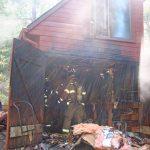 Crews respond to garage fire in Fern Valley