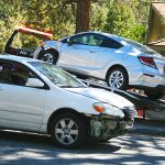 Car crashes into parked vehicle in town