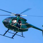 Helicopters surveying Edison lines and poles