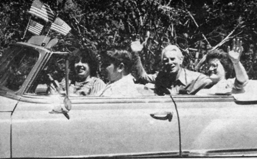 In this July 10, 1980 photo , Fourth of July parade officials rode in a car driven by Tommy Adamson. From left, Linda Murphy, Chamber of Commerce president, Ernie Maxwell, parade marshal, and Jan McKeough, Chamber past president. File photo